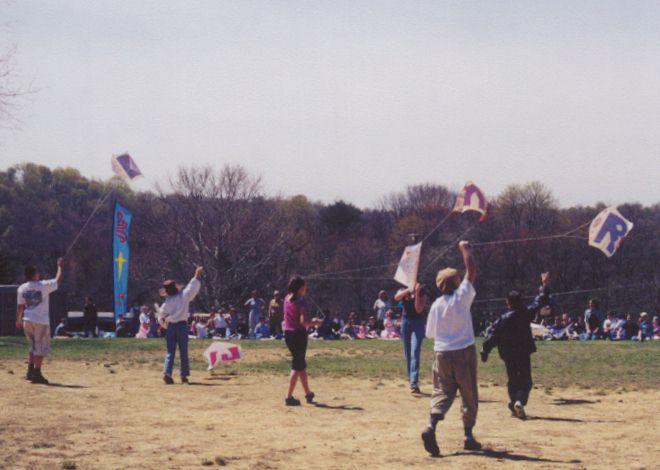 Kids flying their sled kites
